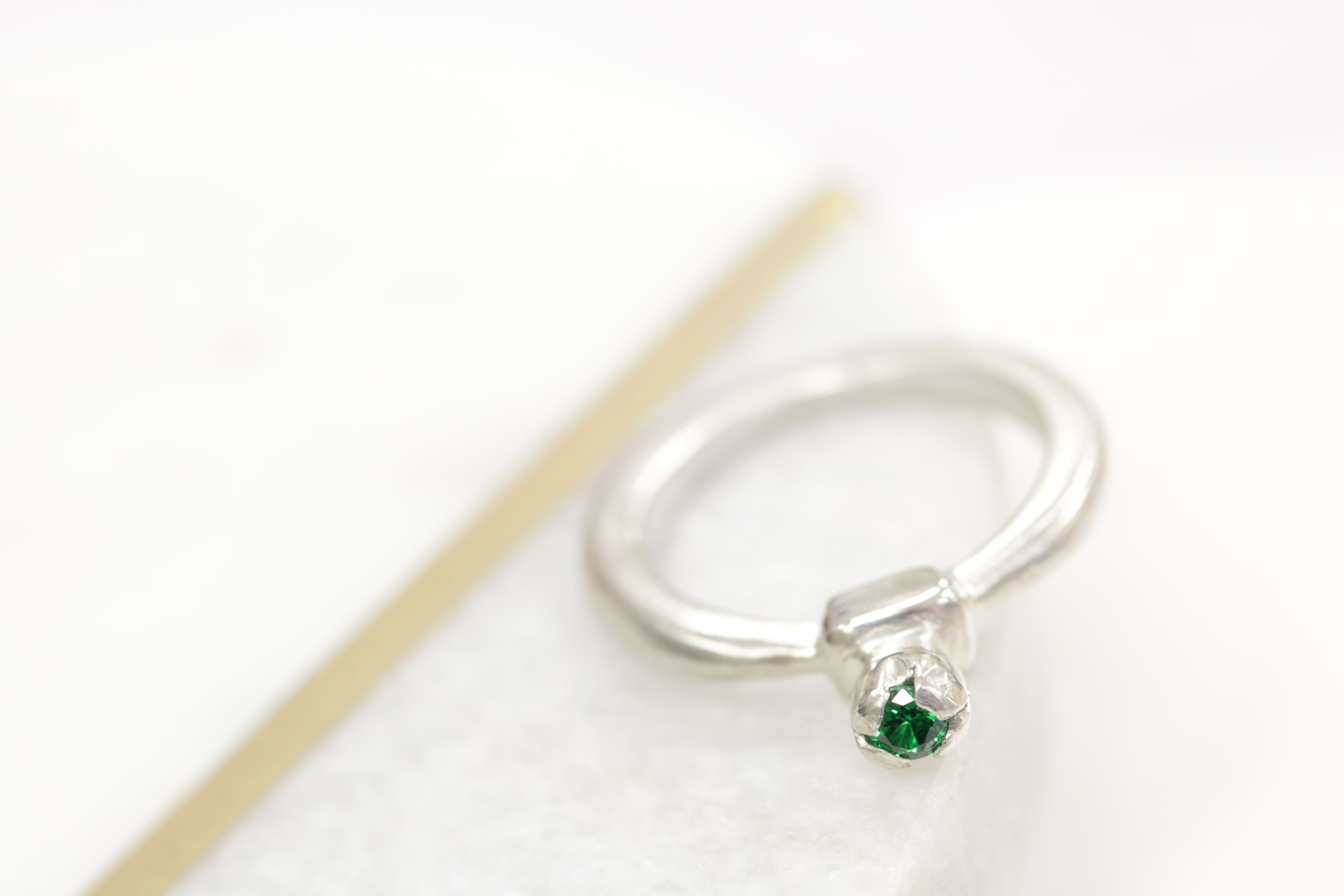 Claw set green CZ ring